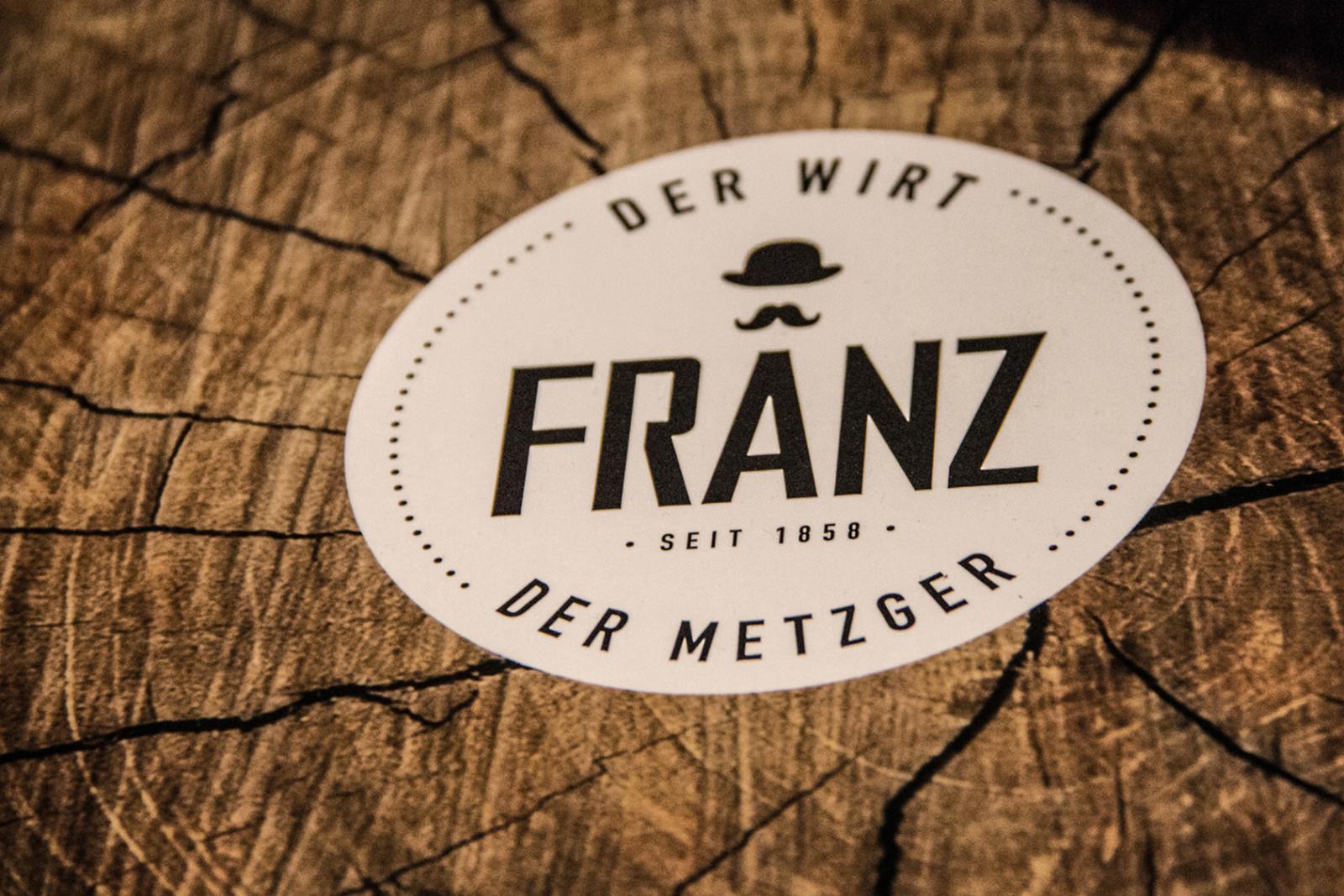 Ein Logo, zwei Mal Genuss: der Metzger und der Wirt.